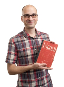 Man with book learning English